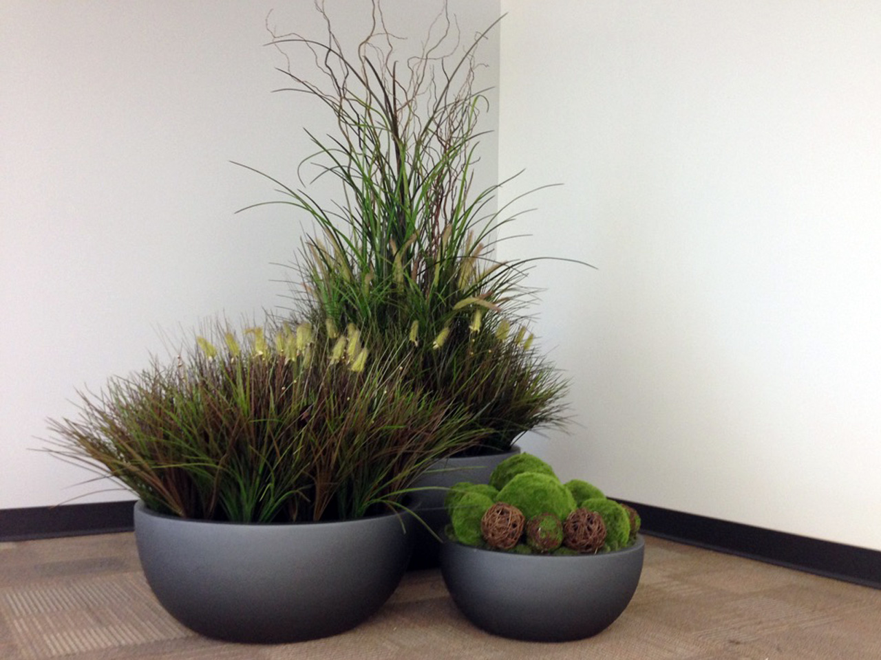 Artificial grasses and preserved moss make a perfect Biophilic combo